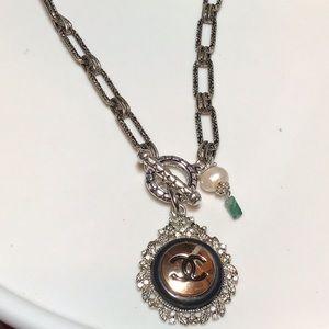 Authentic Pear/Emerald CC Button necklace.